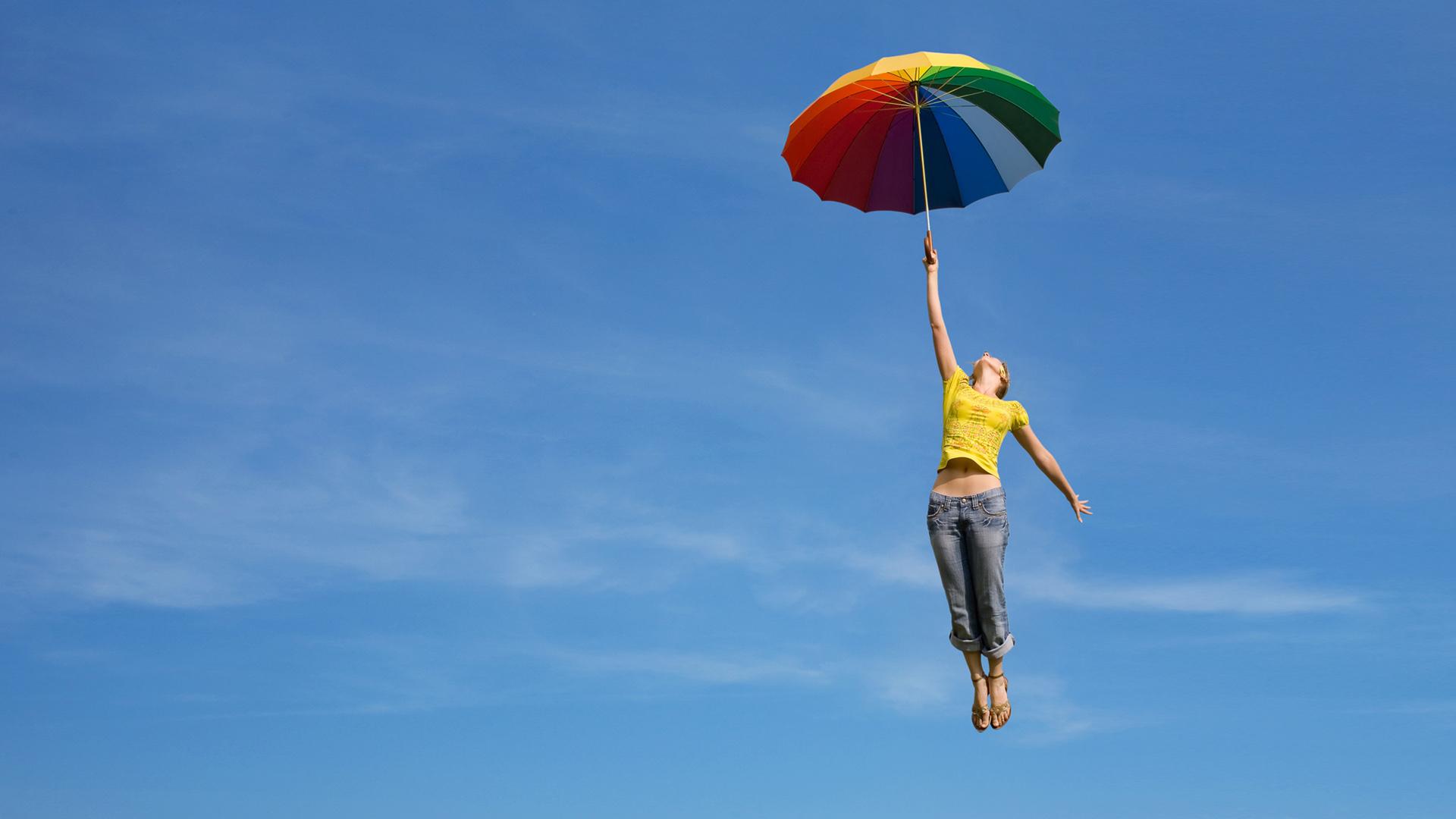 女孩撑着伞飞行天空非主流ppt背景图片下载